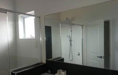 mirror black n white bathroom