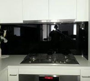 Black splashback white kitchen