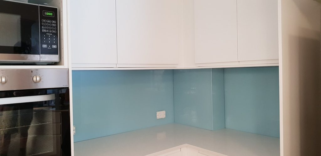 kitchen corner green glass splashback